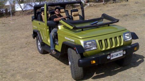 open jeep modified in black colour continued regular indian cars modified into beautiful