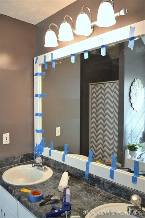 How To Frame A Mirror In Bathroom by How To Frame Out That Builder Basic Bathroom Mirror For