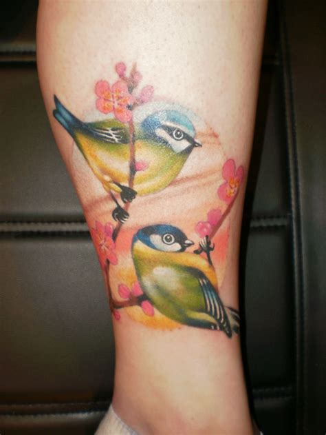pajaros flores tatuajes  mujeres