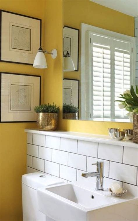 small bathroom with yellow wall colors and houseplants