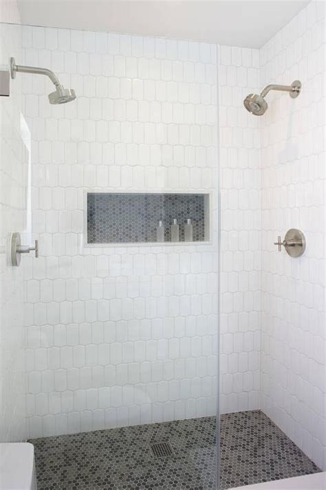 spacious walk  shower boasts walls clad  white
