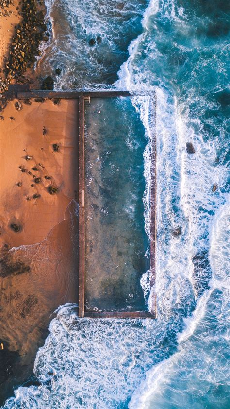 aerial view  beach rocks ocean iphone wallpaper iphone