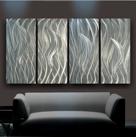 photo wall hanging ideas decorating sheet metal wall and luxury gray sofa on