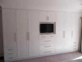 Built In Bedroom Cupboard Designs by White Bedroom Cupboards With Stylish Television Built In