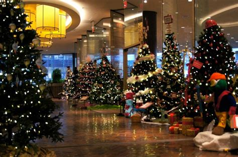 a lobby lined with trees at four seasons hotel vancouver makes a fantastically festive scene