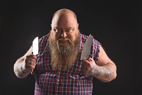 Fat Guy With Knife Expressing His Aggression Stock Photo