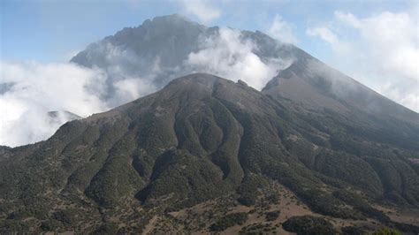 From middle english mount, munt, from old english munt, from latin mons (a hill, mountain), from a root seen also in ēmineō (i project, i protrude) (english eminent). Mount Meru, Tanzania - Garnet Tours