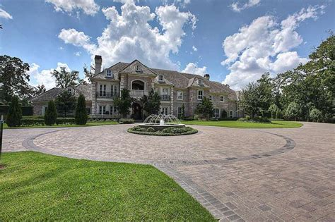 nfls adrian petersons woodlands mansion price reduced