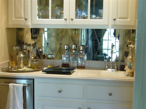 i can t resist this antiqued mirror tile backsplash