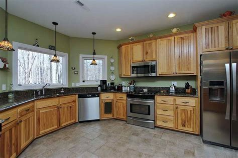 Hickory Kitchen Cabinets With dark Counters & stainless
