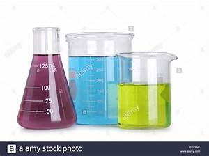 Group of science flasks with colored liquids cut out on ...