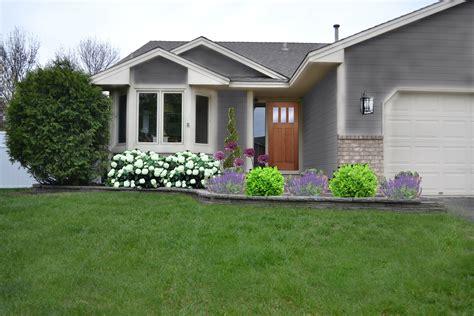 modern grey wall house  white door  garden  front