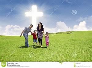 Christian Family Running In Park Stock Image - Image: 29167113