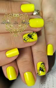 Yellow color nail art design : Summer nail art design is associated with all the funky colors