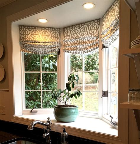 bay window decor custom roman shades in lacefield imperial bisque fabric by the yard via cottage and vine blog