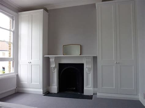Built In Cupboards Next To Fireplace by White Built In Wardrobe Doors Around Fireplace