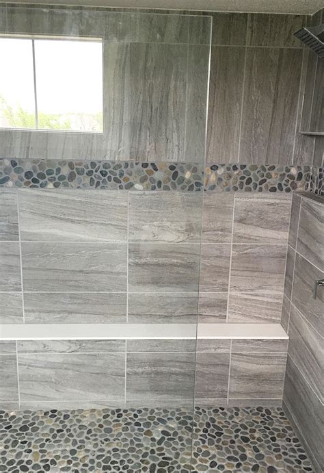 tile format gray stone look large format wall tile with pebble mosaic accent and shower floor master