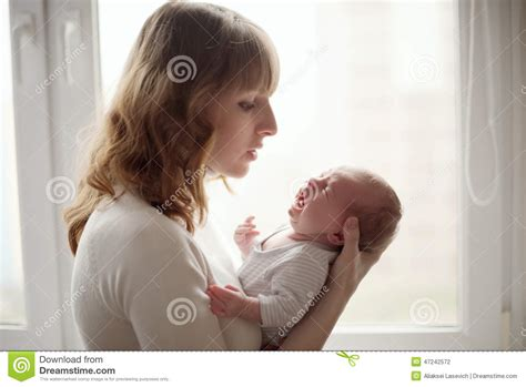 Young Mother With Crying Baby Stock Photo Image 47242572