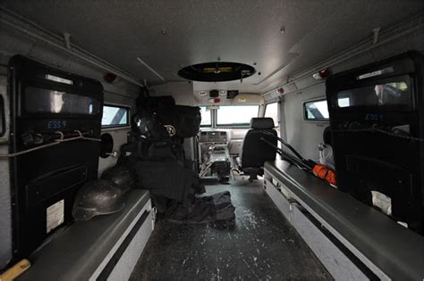 armored vehicles inside arsenal of big rigs and armored trucks in new york police
