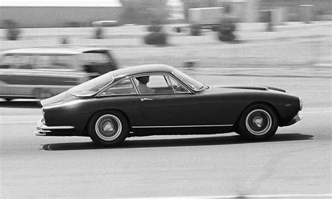 At the wheel of Steve McQueen's £5m Ferrari 250 GT ...