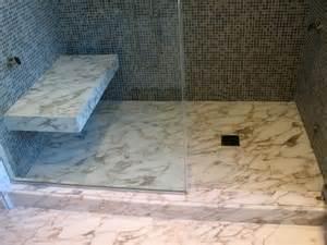 custom calacatta slab floor vein match shower curb