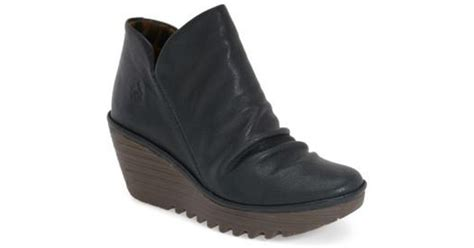 Fly London 'yip' Wedge Bootie In Blue