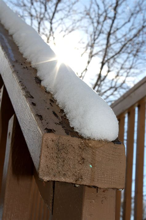 Melt For Wood Decks by Melting Snow On Deck Rail Picture Free Photograph
