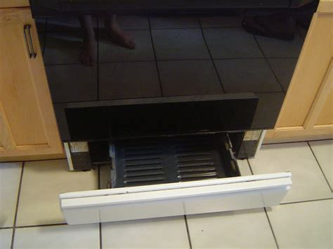 oven broiler kitten with a whisk how to basics broiling in a gas oven