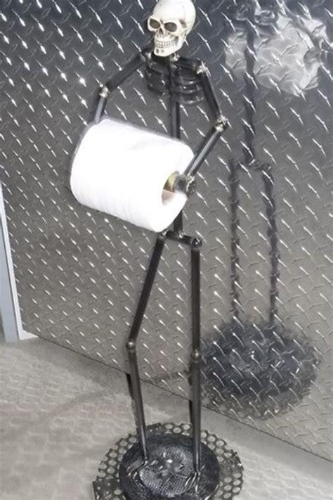 man cave entertaining decor toilet paper holder skull decor