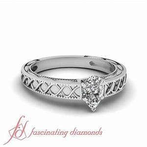 75 tcw pear shape diamond cross wave solitaire engagement With wave shaped wedding rings
