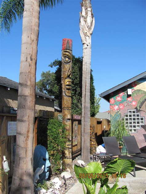Palm Tiki by Palm Tree Stump Carved Into A Tiki Statue Backyard