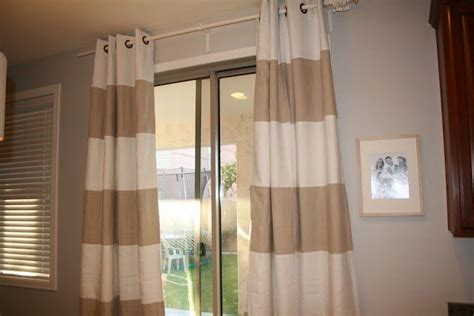 and white striped drapes can also use as a shower