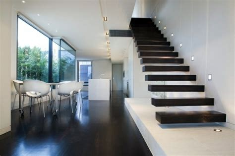 brick wall in house 101 modern stairs appear as an eye catcher in your home