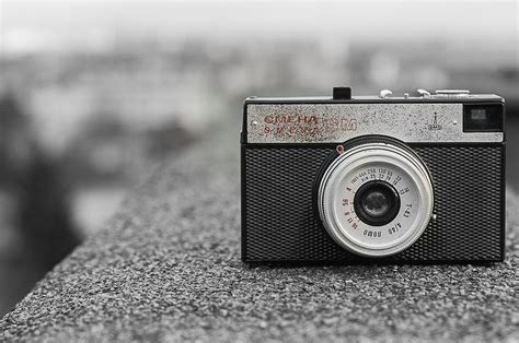 black  gray classic camera  gray concrete