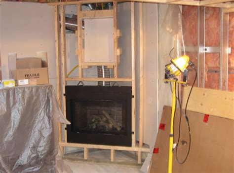 of images framing corner fireplace basement finishing by jennan construction residential