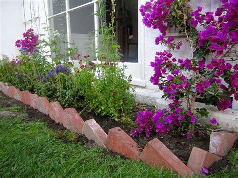 Bricks Set On Angle As Garden Border.
