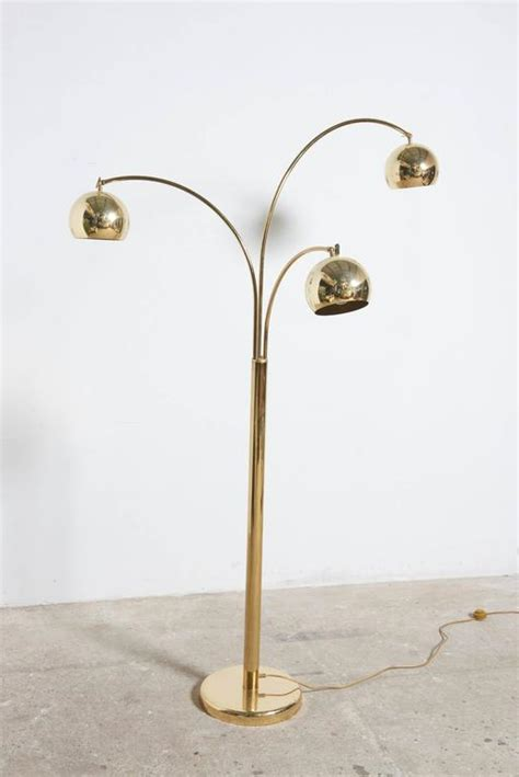 adjustable arc floor l brass arc floor l with three adjustable arms by