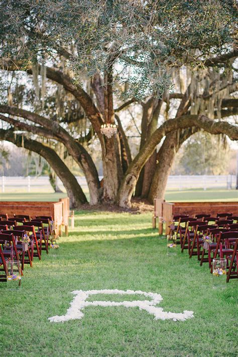 ranch inspired outdoor wedding ceremony altar and seating