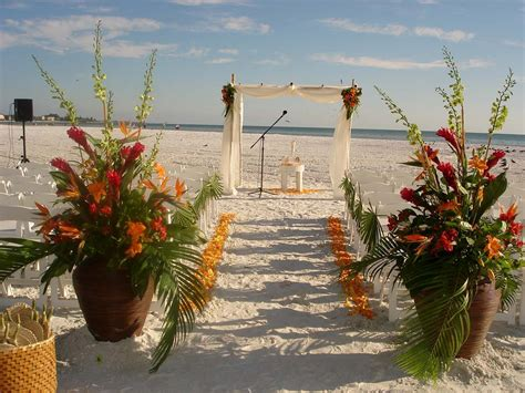 Beach Set Up With Fabric And Bamboo Canopy And Florals At