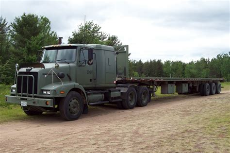 military trailer cer dnd 84n western star truck with a triaxle tridem flatbed t