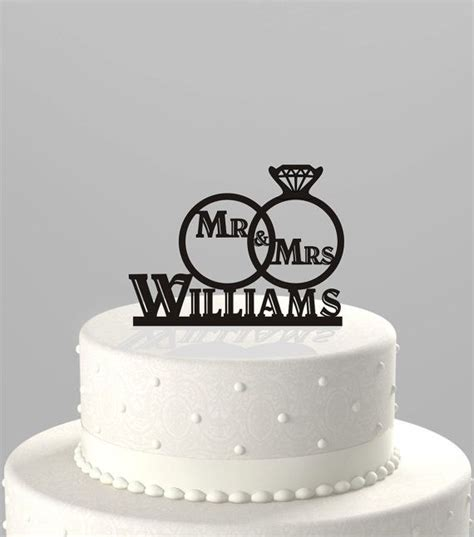 wedding cake topper of a wedding ring set with mr mrs