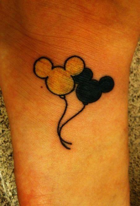 white  black mickey mouse tattoo  arm tattoomagz