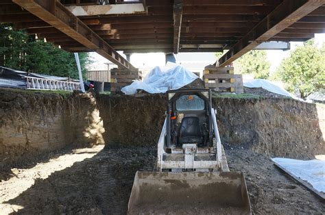 lifting a garage from the foundation foundation systems restoration repair new basement house