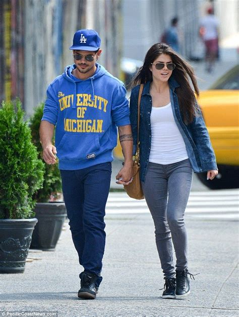 Celebrity couple Taylor Lautner and Marie Avgeropoulous in ...