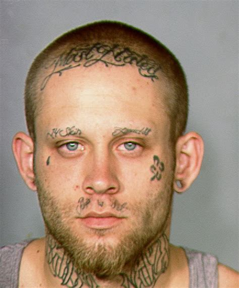 Nazi Tattoos Robbery Suspect Tattoos To Be Concealed