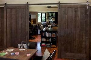 using barn doors as a statement in interior design With barn door room separator