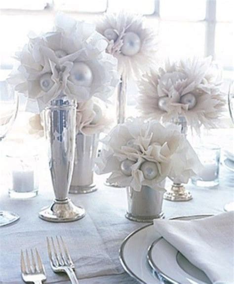 simple winter centerpieces winter table decor not sure what it s made from christmas bulbs and tissue or coffee filter