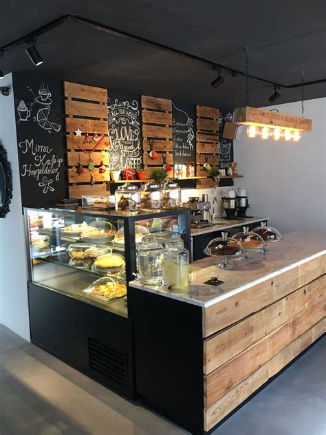 The hero section includes a background image with a title and tagline is a small overlay with the products section show products with circular images. Coffee Shop Counter Design