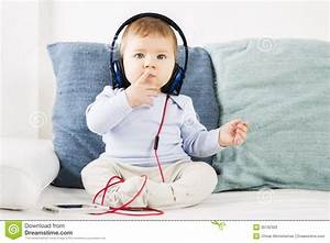 Adorable Baby Boy Listening Music At Earphones. Royalty ...