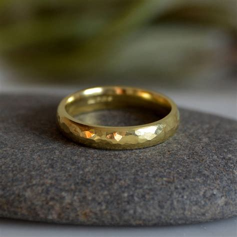 hammered effect wedding band in 18ct yellow gold by huiyi